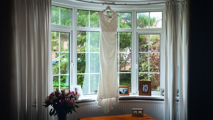 wedding videographer leeds oulton hall town hall montage videography bridal dress
